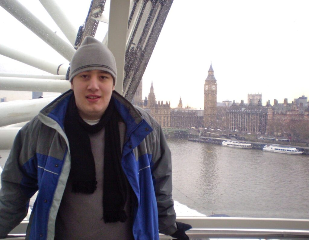Nathan in front of the London Eye