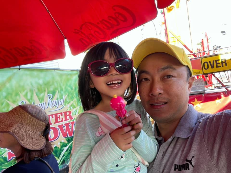 Maddie withy her father Alan at the Easter show